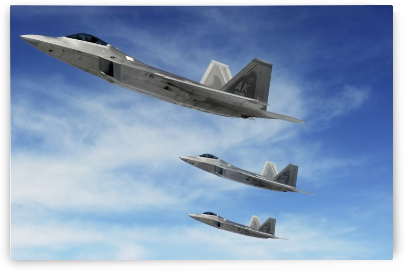 A three-ship formation of F-22 Raptors. by StocktrekImages
