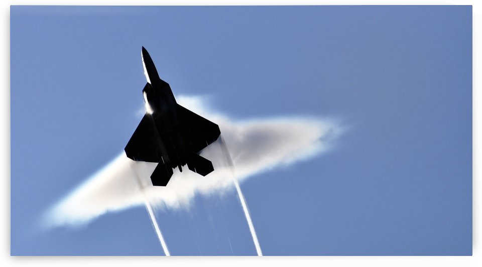 A U.S. Air Force F-22 Raptor aircraft executing a supersonic flyby. by StocktrekImages