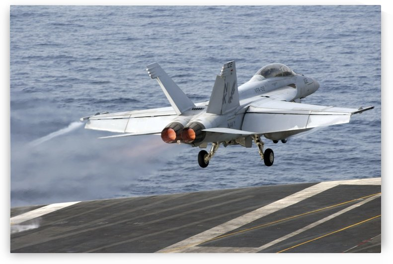 An F-A-18F Super Hornet launches from the aircraft carrier USS Ronald Reagan. by StocktrekImages
