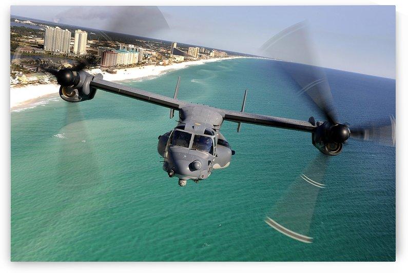 A CV-22 Osprey aircraft flies over Floridas Emerald Coast. by StocktrekImages