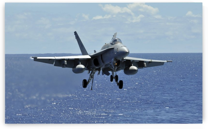 An F-A-18C Hornet approaches the flight deck of the aircraft carrier USS Ronald Reagan. by StocktrekImages