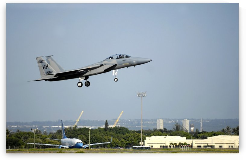 An F-15A Eagle returns to Hickam Air Force Base. by StocktrekImages