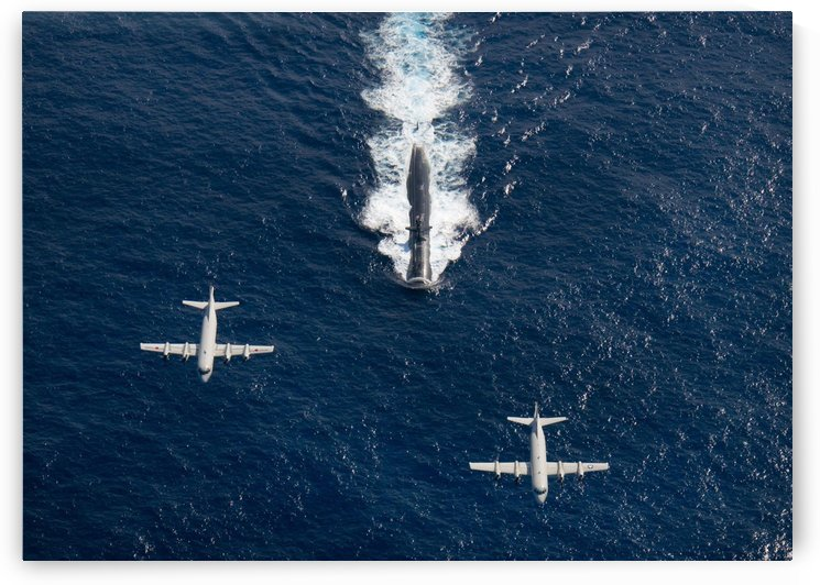 Two P-3 Orion maritime surveillance aircraft fly over attack submarine USS Houston. by StocktrekImages