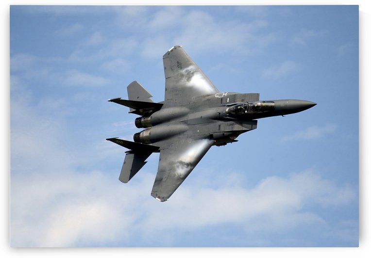 An F-15E Strike Eagle soars through the sky. by StocktrekImages