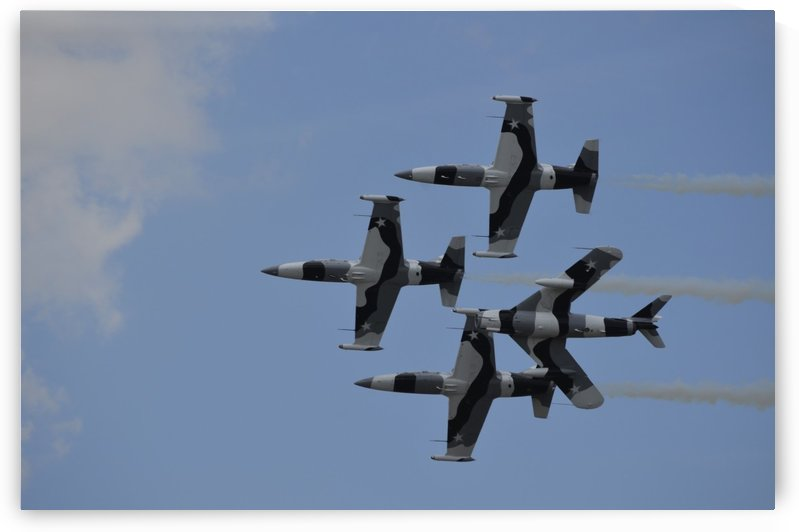 The Black Diamond Jet Team fly in diamond formation. by StocktrekImages