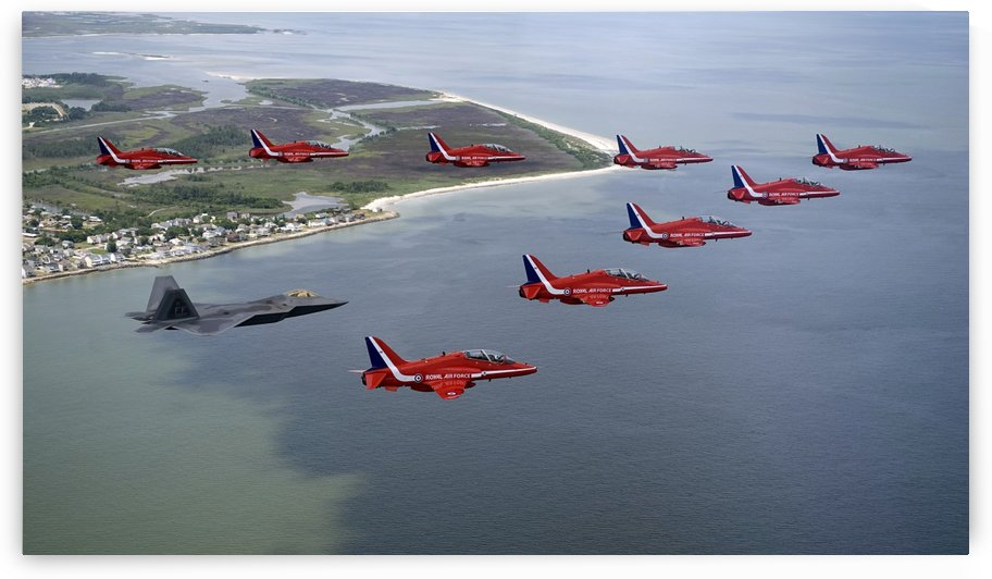 A F-22 Raptor flies in formation with the Royal Air Force Aerobatic Team The Red Arrows. by StocktrekImages