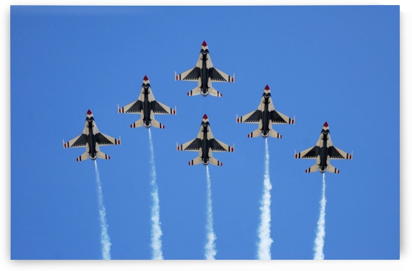 The U.S. Air Force Thunderbirds perform a 6-ship formation flyby during an air show. by StocktrekImages