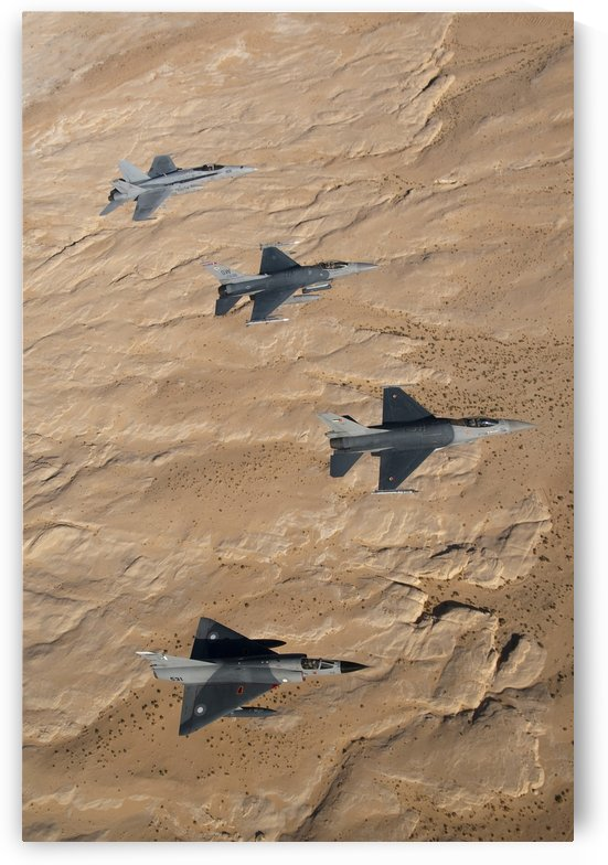 Military fighter jets fly in formation over Jordan. by StocktrekImages