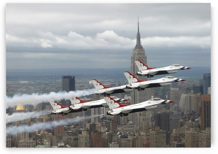 Six F-16 Fighting Falcons with the U.S. Air Force Thunderbirds fly in delta formation. by StocktrekImages