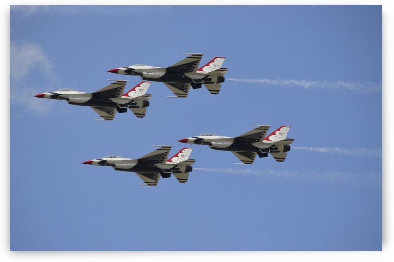 The U.S. Air Force Thunderbirds fly in formation. by StocktrekImages
