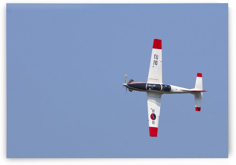 A T-50 Golden Eagle aircraft in flight. by StocktrekImages
