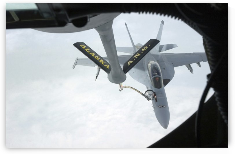 A Navy F-A-18F Super Hornet is refueled by a KC-135R Stratotanker. by StocktrekImages