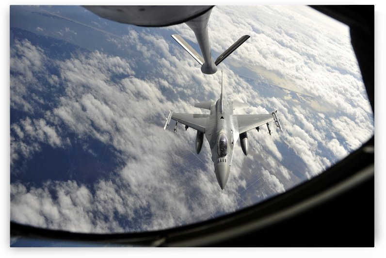 An F-16 Fighting Falcon prepares for aerial refueling. by StocktrekImages