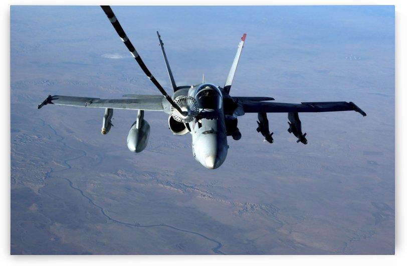 An F-A-18C Hornet receives fuel from a U.S. Air Force KC-10 Extender. by StocktrekImages
