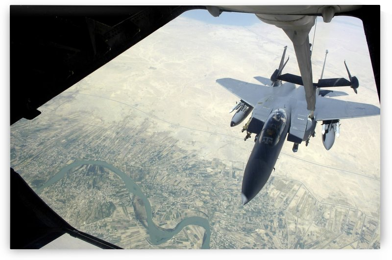 An F-15E Strike Eagle receives fuel from a KC-10 Extender. by StocktrekImages