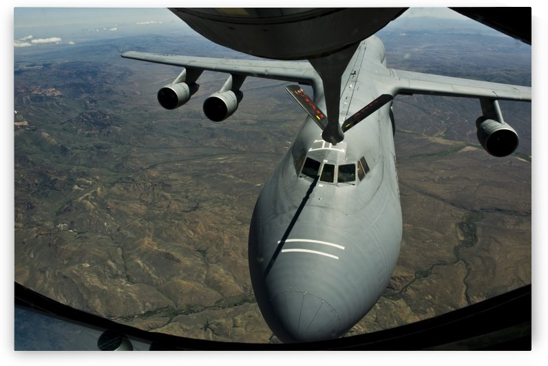 A U.S. Air Force KC-135R Stratotanker aircraft refuels a C-5B Galaxy. by StocktrekImages