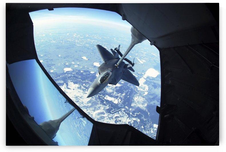 A F-22 Raptor refuels behind a KC-10 Extender. by StocktrekImages