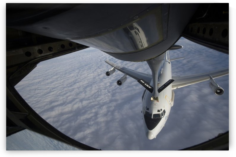 A KC-135 Stratotanker refuels a NATO E-3 Sentry aircraft. by StocktrekImages
