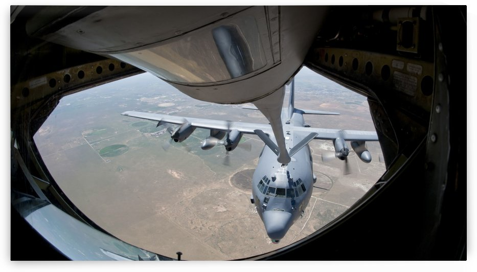 A U.S. Air Force AC-130W Stinger II receiving fuel. by StocktrekImages