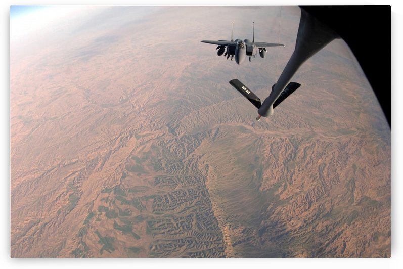 An F-15E Strike Eagle is refueled by a KC-135 Stratotanker. by StocktrekImages