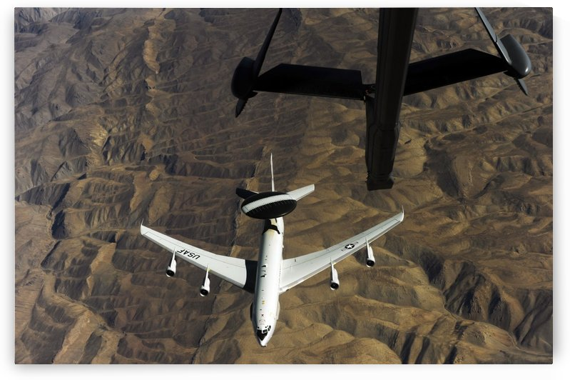 A U.S. Air Force E-3 Sentry aircraft over Afghanistan. by StocktrekImages