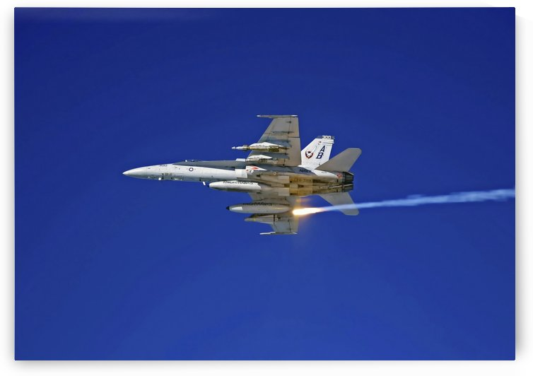 An F-A-18C Hornet testing its flare countermeasures system prior to heading into Iraq. by StocktrekImages