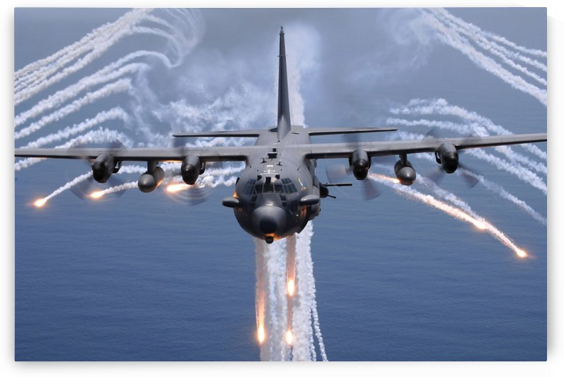 An AC-130H gunship aircraft jettisons flares as an infrared countermeasure. by StocktrekImages