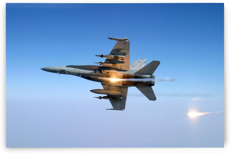 An F-A-18C Hornet aircraft tests its flare countermeasure system. by StocktrekImages