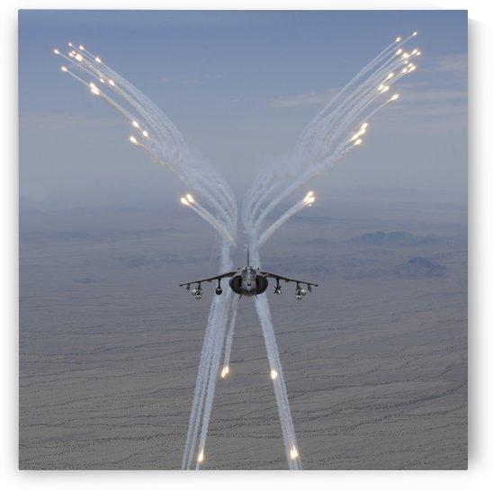 An AV-8B Harrier fires flares during a training flight. by StocktrekImages