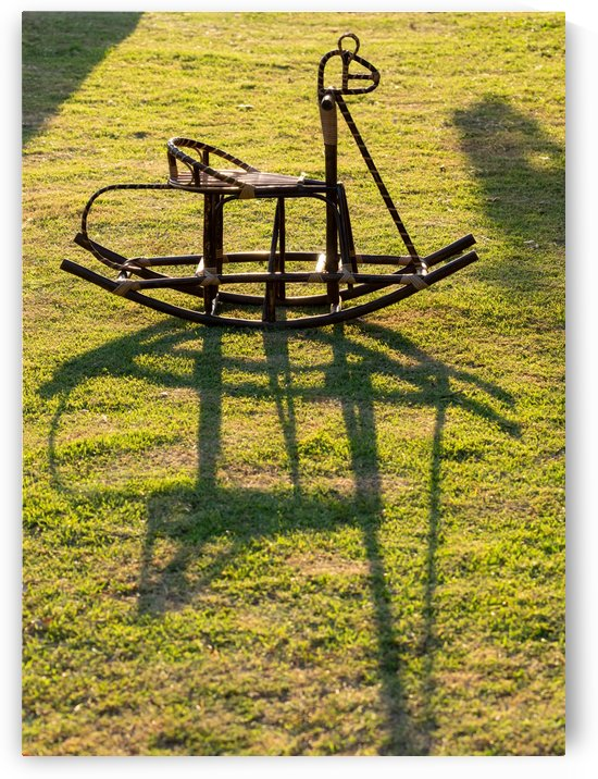 Rocking horse wicker in grass field by Krit of Studio OMG
