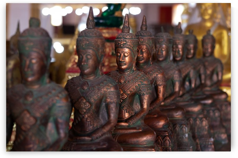 Copper buddha statue in a row by Krit of Studio OMG