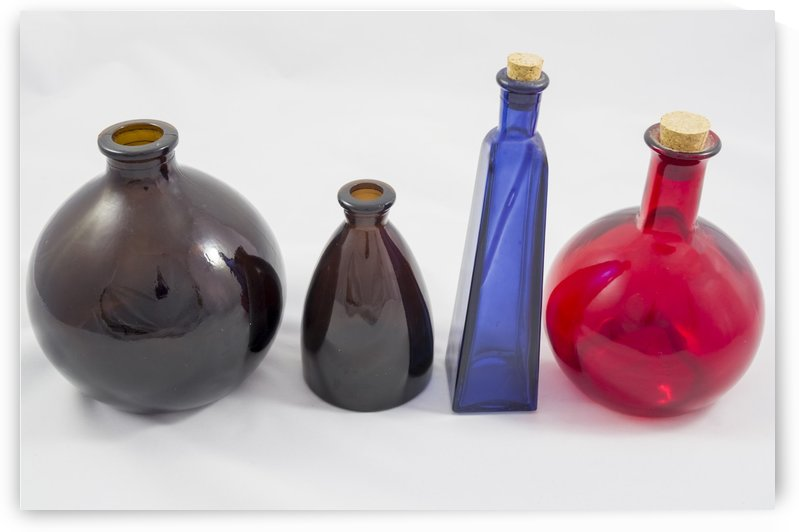 Group of old coloured glass bottles by Bob Corson