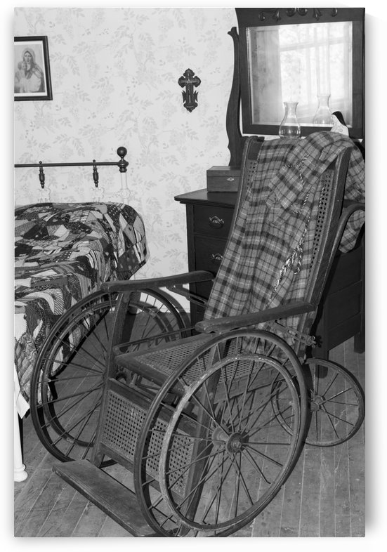 Antique wooden wheel chair bw by Bob Corson