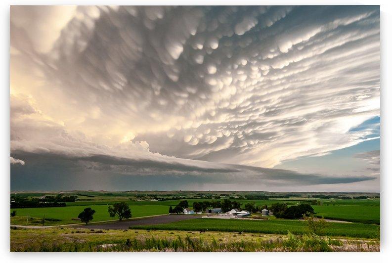 Mammatus Clouds Behind Thunderstorm by Garald Horst