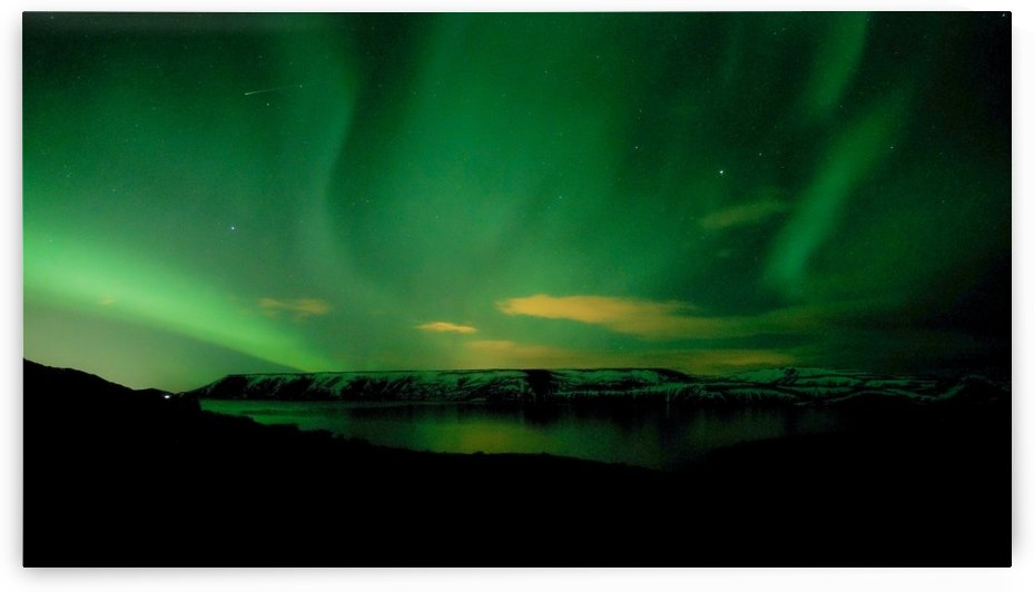 green northern lights on lake by By the C Media
