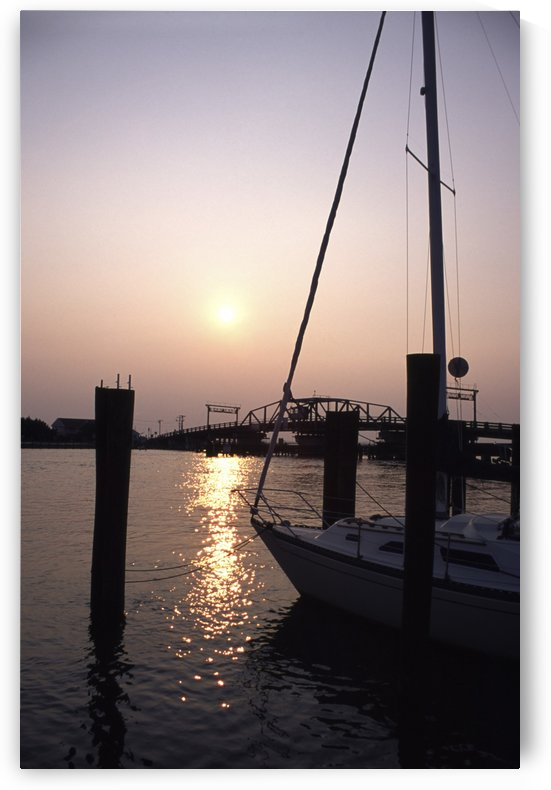 Chincoteague sunset In Harbour With SailBoat On Right Vertical View by Atelier Knox