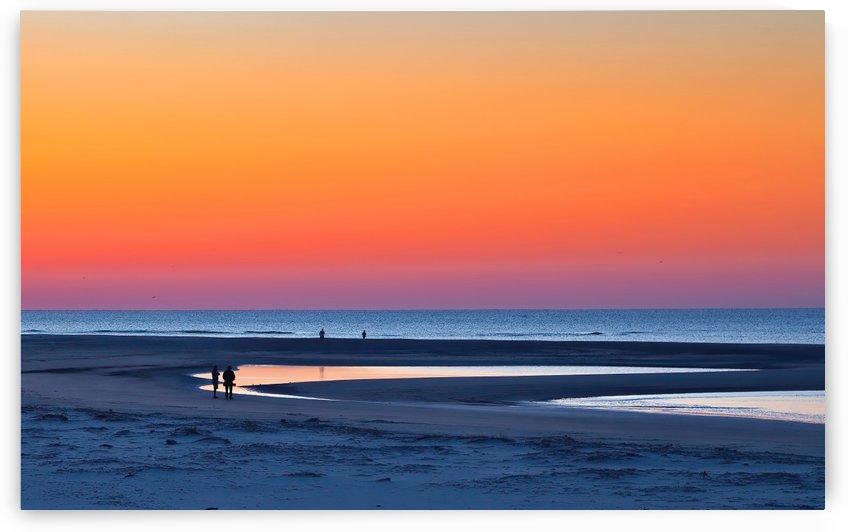 Early Morning Walk Under Orange Sunrise by Darryl Brooks