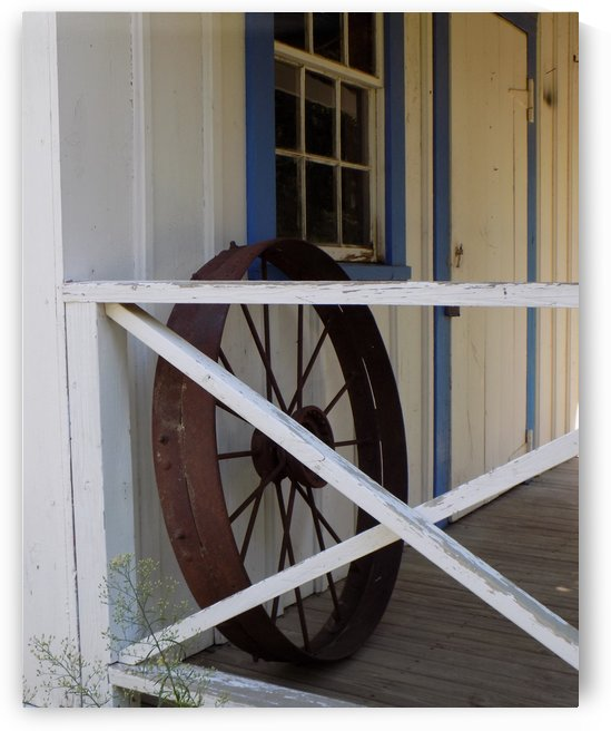 Wagon Wheel on Porch by Castle Green Enterprises