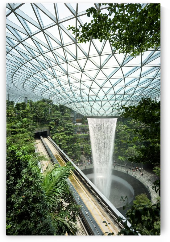 Jewel Changi Airport in Singapore a glass dome with indoor waterfall and forest shopping mall terminal and hotel by Em Campos