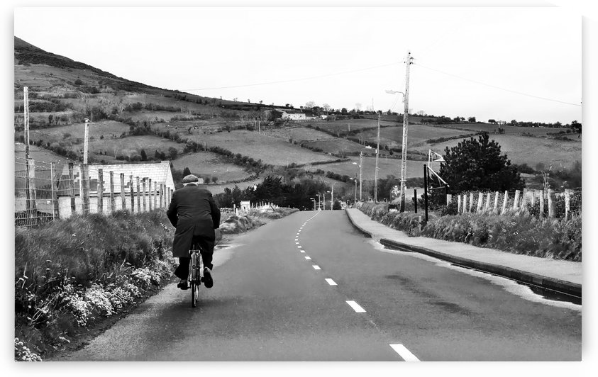 Gentleman Cycling in Northern Ireland in B&W  by Lexa Harpell