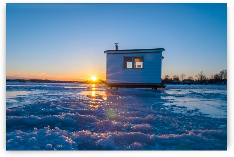 Sunset Ice fishing hut in the frozen lake by RezieMart