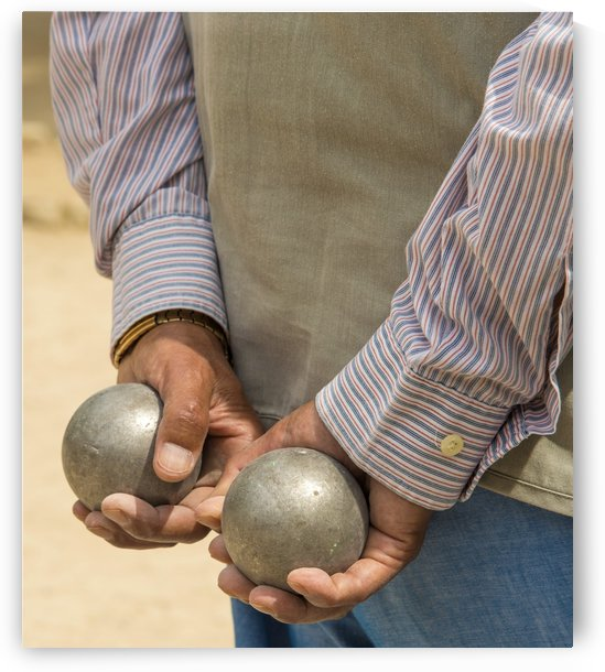 Petanque player holding balls. by Downundershooter