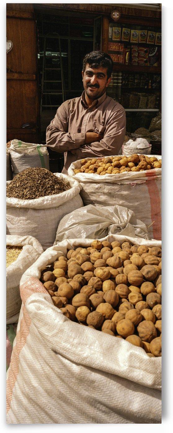 Shop keeper behind Bags of Dried goods by Downundershooter