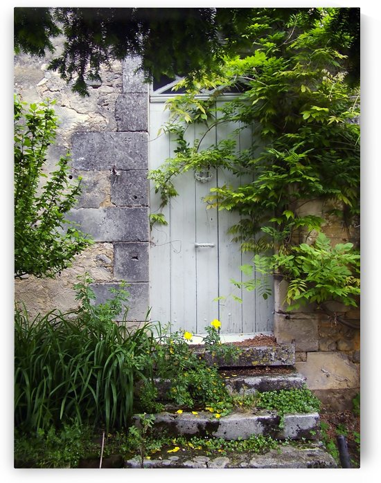 Wooden Door in stone wall Toulouse France. by Downundershooter
