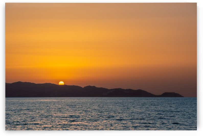 Sun sets in the west by Luigi Girola