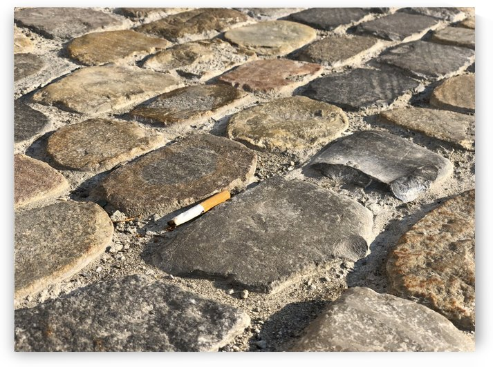 Last or Lost Cigarette on Cobblestone Pavement stop smoking I by Swiss Art by Patrick Kobler
