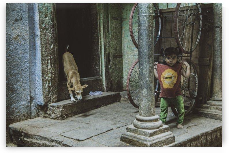 Varanasi girl and dog by Sebastian Dietl