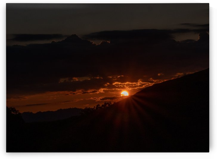 Sun and sun rays at sunset by Raquel Creative