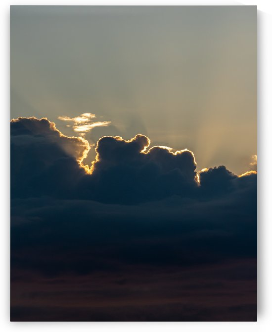 Sun rays behind clouds by Raquel Creative