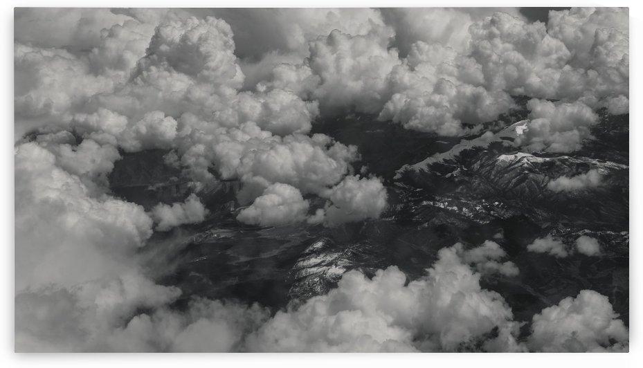 Cloudy Mountain Top Skies by Konstantin